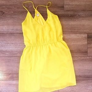 Bright yellow tank with pockets